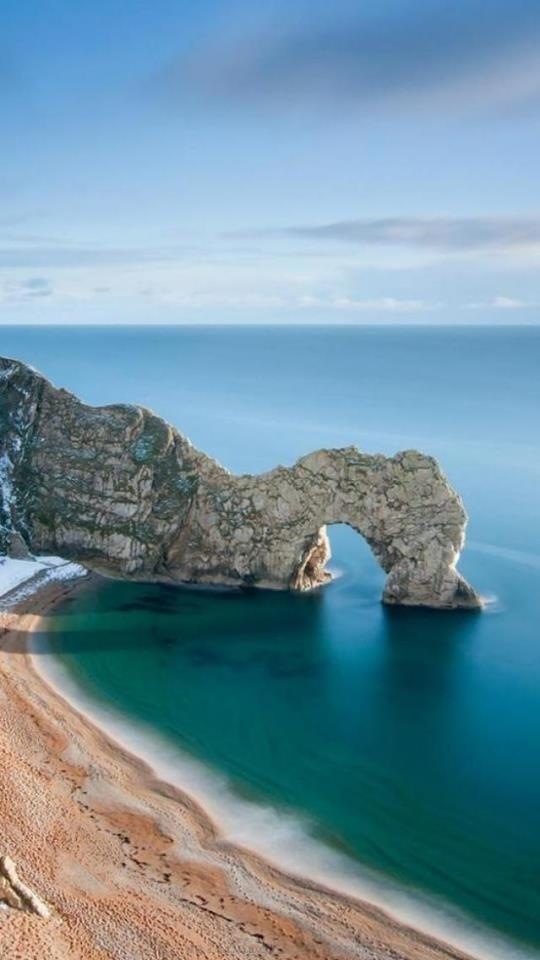 Durdle Door and Man 'O' War beaches are part of the Weld Estate. Shingle beaches which are only accessible on foot via a steep path and steps over the hill from Lulworth Cove or down from Durdle Door Holiday Park where parking is available between 1 March and 31 October. The approximately estimated travel/road distance can be around 31 miles to 33.7 miles