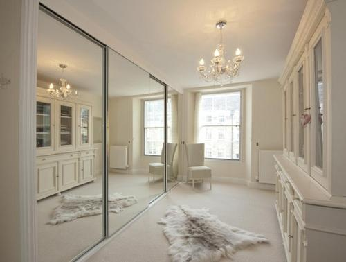 Dressing Room With Full Length Mirror Closet Doors And Built In Cabinets  And Drawers