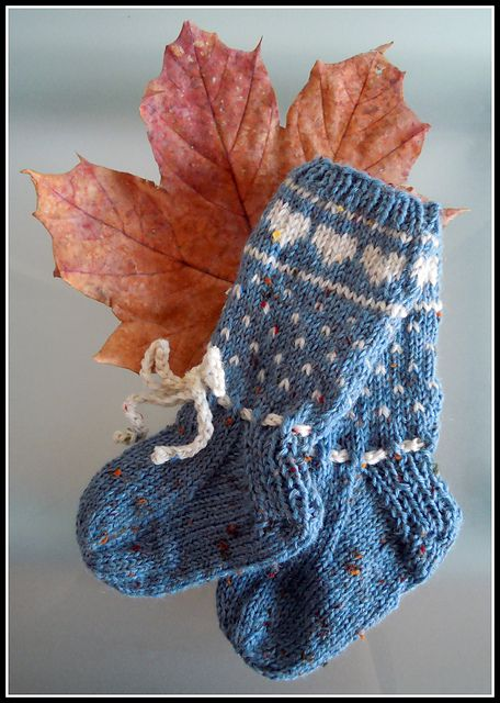 Ravelry: Babys Norwegian Heart Socks pattern by Molly Nichole