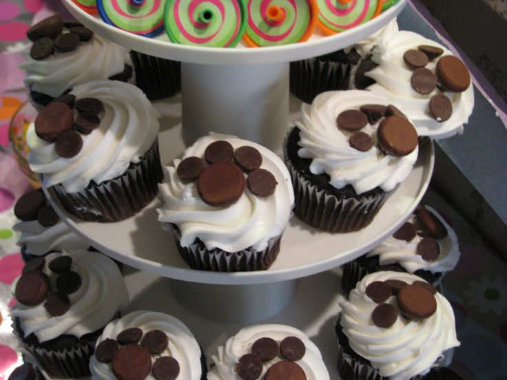 puppy print cup cakes made with chocolate chips and hershey's kisses
