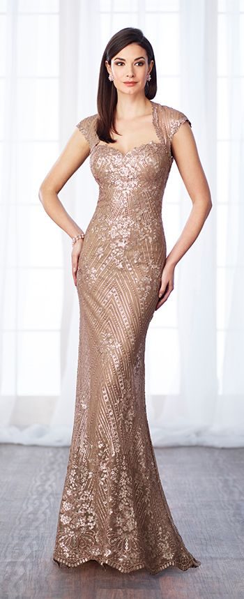 Sequin lace and chiffon fit and flare gown with cap sleeves, Queen Anne neckline, dropped waistline, keyhole back, scalloped hem.