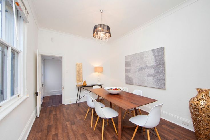 Stylish classic Victorian residence in blue-ribbon village enclave, dining room, replica chairs, timber dining table, wall art, pendant light, 4 Toxteth Road Glebe at Pilcher Residential