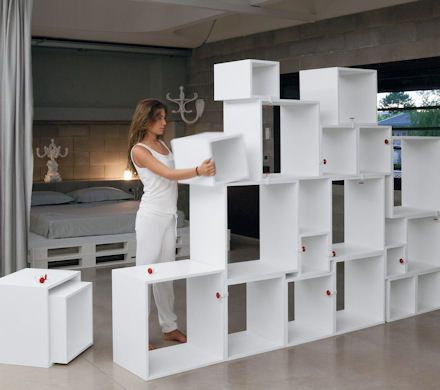 What an awesome Storage idea!!! Not to mention a great wall devider for say a livingroom/dining room