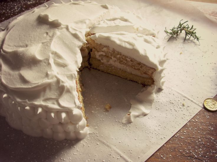 lemon cake with lemon cream and meringue frosting..