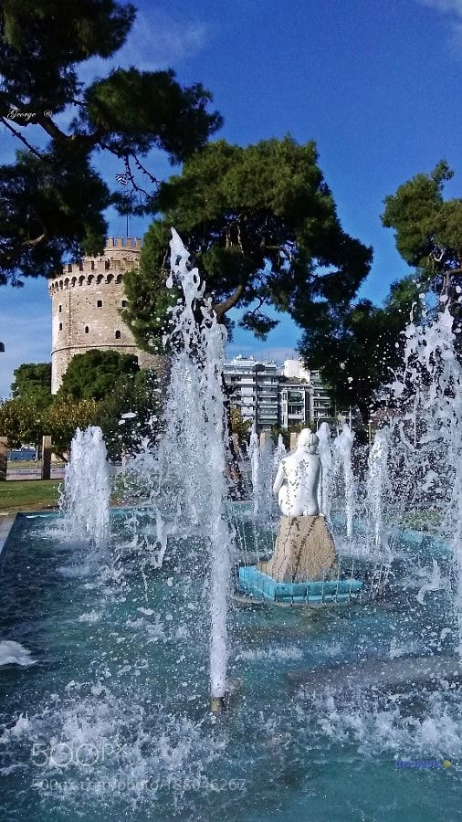 Aphrodite statue of a fountain and the White Tower Thessaloniki - Greece by George_Gr