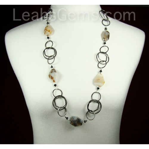 This amazing necklace is made with large pieces of Montana Agate and oxidized 14 karat gold chain. The length is about 32 inches and there is no clasp on the this necklace. It is made to just put right over your head. $95.00