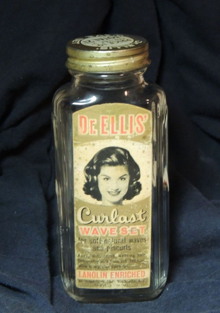 "5-1/4"" tall. Circa late 1930s to early 1950s. Original paper label and lid. There is some wear to the label, but overall the condition is great. Rare Dr. Ellis item. 