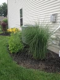 Simple Shrubs And Landscaping Can Hide Large Outdoor Air