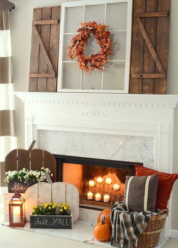 For a true Pinterest-worthy home – look straight to the mantel! It's the center of attention in your living room and it doesn't take much to decorate it for the coming fall season! A few candles, a garland of leaves, an autumn wreath, and – viola!