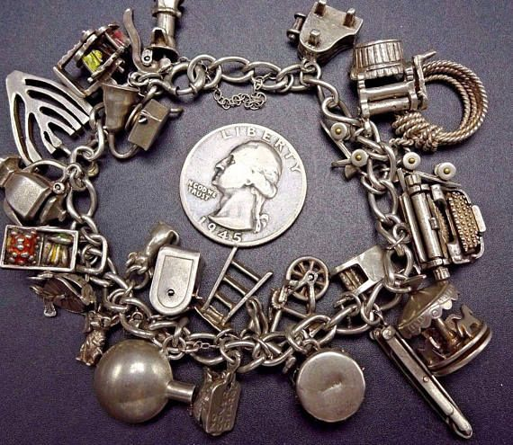 VINTAGE ROUTE 66 CHARM BRACELET   DESCRIPTION: This exquisite collectible features southwestern sterling silver charms, from the glory days of Route 66 auto travel. Safety chain attached to the clasp holds this beauty safely on your wrist.  Water pump (moving parts) Ferris Wheel (moving parts) Old Phonograph (moving parts) Candelabra Teapot (moving parts) Miners Cart (moving parts) Turtle/Tortoise 3 Blind Mice U.S. Mailbox Canteen Step Ladder Hen with Chicks No Cover Charge (moving parts...