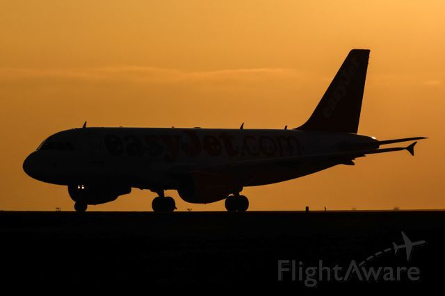 Sunset caption Airbus A319 (HB-JZO)