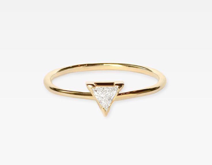 This unique trillionring features a beautiful .15ct trillion-cut diamond, set in a simple 14k solid yellow gold band.Wear thiscontemporary design stacked with others orlet it stand outon it's own.If you need help with sizing, please visit our sizing chart ororderour physicalring sizer for exact results.Pair with our Trillion Diamond Earrings&Trillion...