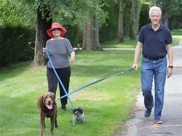 Bill and Hillary Clinton and their dogs.