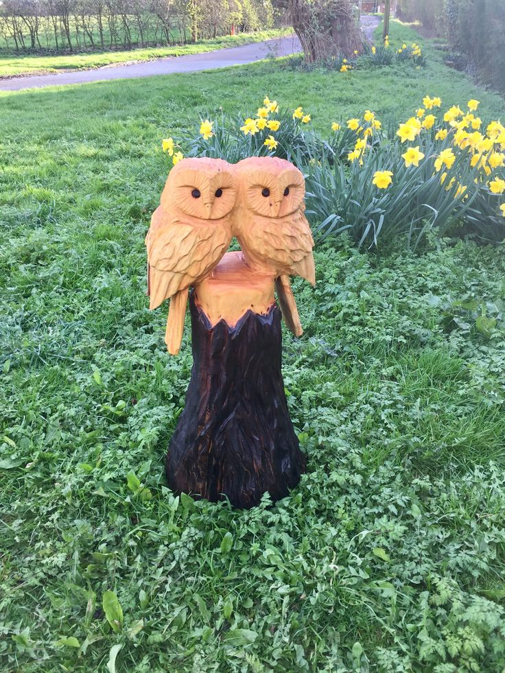 Pair of chainsaw carved owls