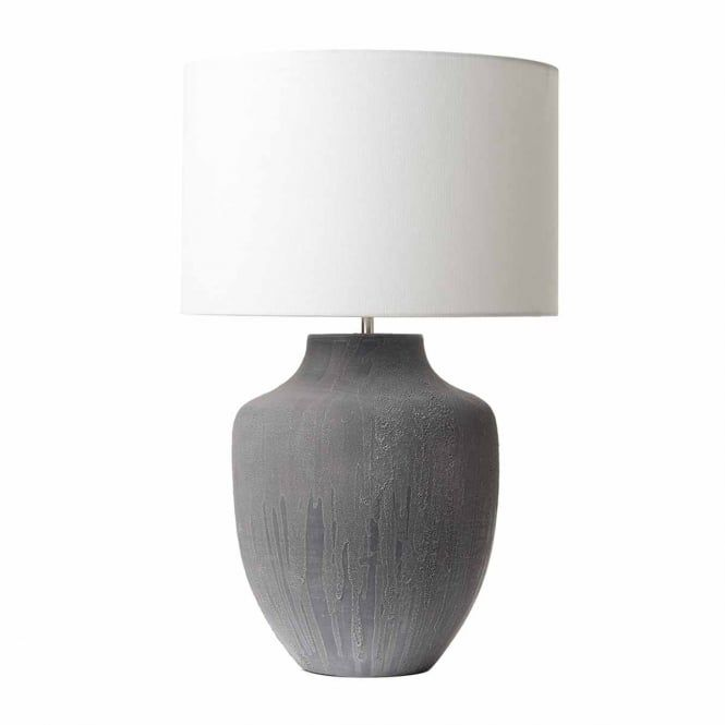 A rustic style ceramic table lamp base with a two tone hand applied glaze in a grey finish. This is a lamp base only and does not come with a shade. This would be great for lighting in a traditional lounge or bedroom. This light is double insulated for safe use without need of an earth wire. The light is individually switched by an inline rocker switch.