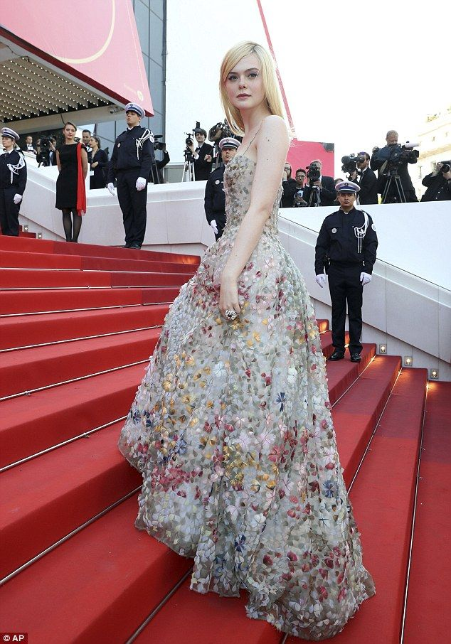 Elle Fanning in a floral embellished tulle spaghetti-strap prom gown by Christian Dior: 2017 Cannes Film Festival