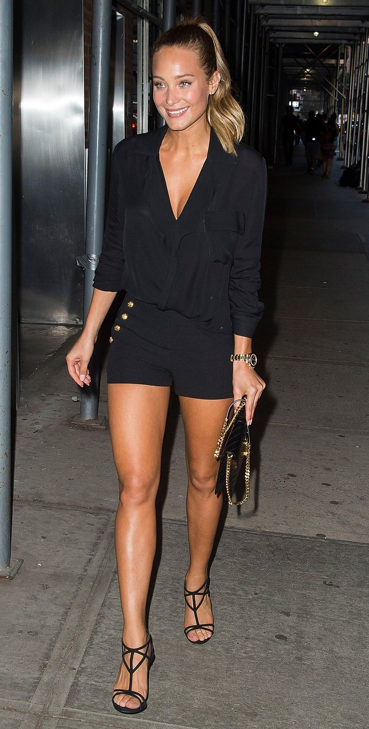 Hannah Davis in an all black look with gold details