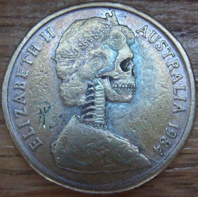 Paul Holbrecht 'Skulled Queen' coin carving in a 1984 Australian $