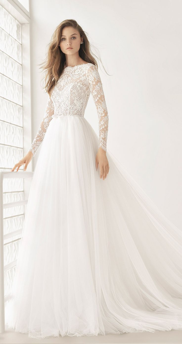 POEMA wedding dress by Rosa Clará. It doesn't get any prettier than this! Feel like a real princess in this exquisite design with fitted waist that combines a beaded embroidered lace bodice, long sleeves and bateau neckline finished with lace scalloping and a spectacular tulle skirt. @rosa_clara #rosaclara #rosaclarabride #rosaclara2018 #weddingdress #tulle #weddinggown #ballgown #romantic #bridal #wedding #sponsored