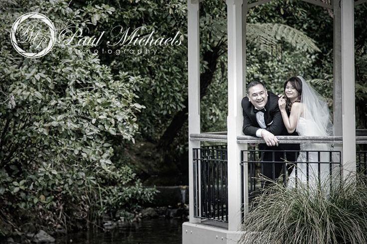 Wedding couple at the duck pond.  #wedding #photography. PaulMichaels www.paulmichaels.co.nz photographers