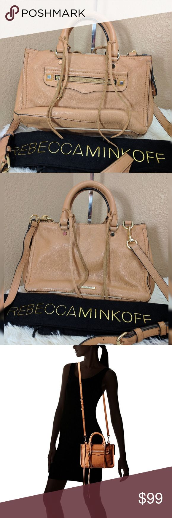 "Rebecca Minkoff Micro Regan Satchel Butter Rum Cowhide Leather  Imported  Synthetic lining  Zipper closure  25"" shoulder drop  6.25"" high  9.5"" wide  Micro top-handle bag in pebbled leather featuring long fringe at zipper pulls and handle fobs  Removable/adjustable cross-body strap  9.4 x 3.1 x 6.7 inches  Stitching repaired on two corners see last photo for example.  Otherwise excellent condition. Rebecca Minkoff Bags Crossbody Bags"