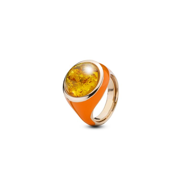 House of Amber - A magnificent ring in rose gold sterling silver, orange enamel, and cognac amber. The ring has a magnetizing design and is a part of the Enlightened Enamel Collection.