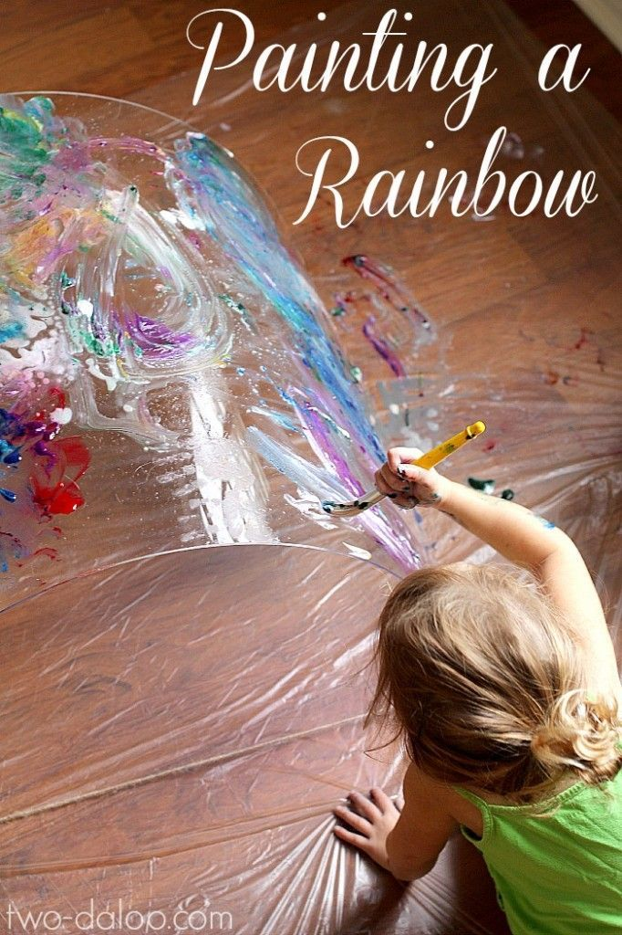 Use a sheet of Plexiglass and fingerpaint to make a rainbow tunnel to explore color: A  Reggio-inspired big art project for toddlers.