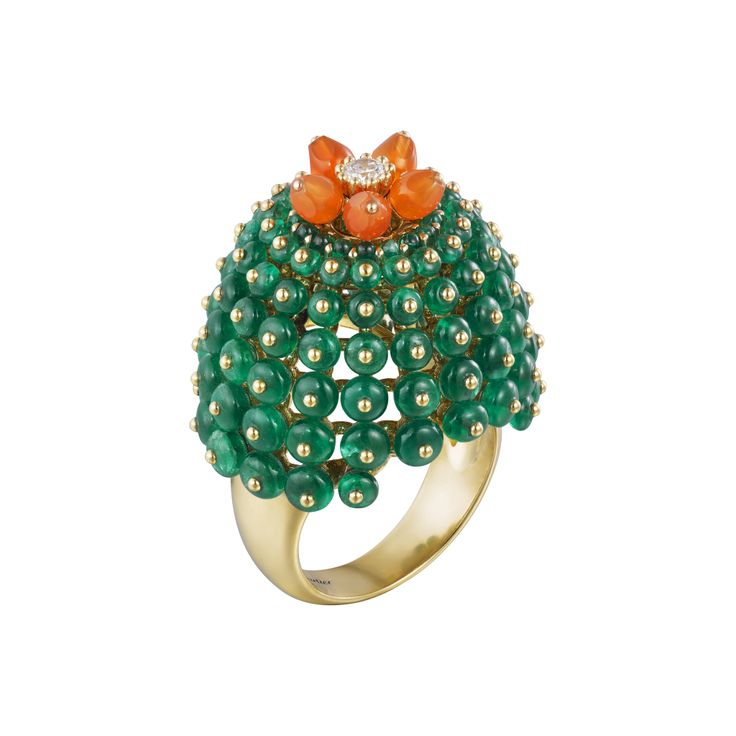 A ring from the Cactus de Cartier collection set with emeralds and carnelian cactus drops