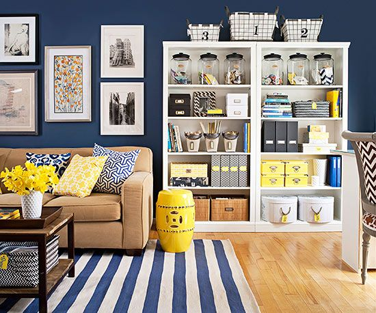 Declutter Your Living RoomUse decorative containers to streamline clutter on bookshelves that straddle seating and working areas