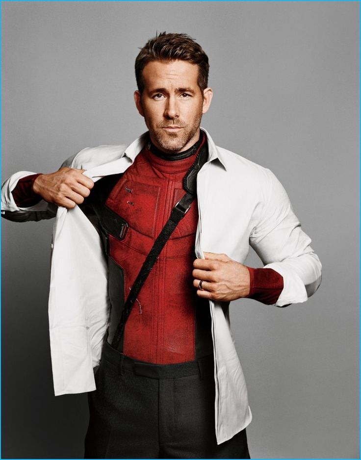 Alasdair McLellan photographs Ryan Reynolds in a white shirt, tie, and suit from Dior Homme.