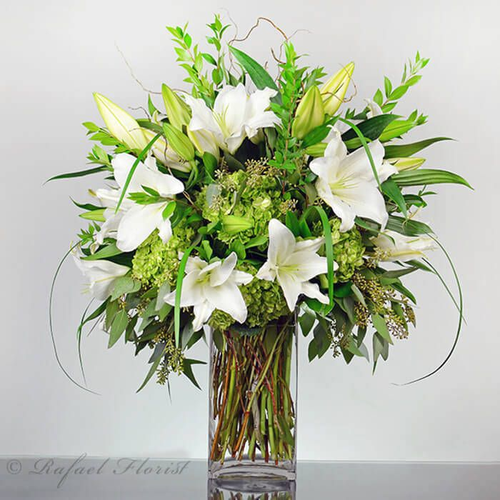 Fragrant And Serene Floral Arrangement Of Green Hydrangea And White Casablanca Lilies Hydrangea Flower Arrangements Flower Arrangements Simple Memorial Flowers