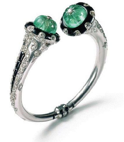 Cartier Indian Inspired Carved Emerald, Onyx and Diamond Bangle Circa 1925