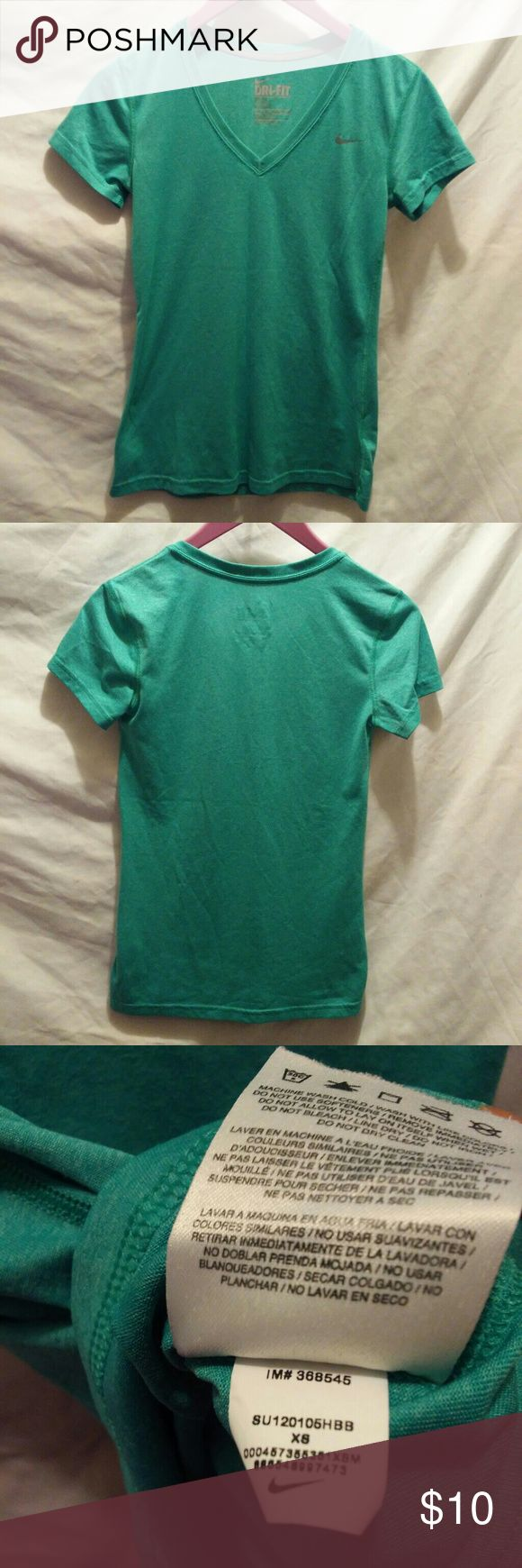 """Nike dri fit v neck t shirt in green Green pastel colors V neck Armpit to pit laying flat 15.5"""" Length from top shoulder to hem 24.5"""" Great condition Nike Tops"""