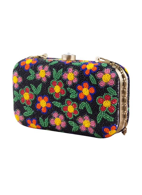 Covered in multicolored beads, this pretty handcrafted clutch from The Purple Sack is a darling addition to any outfit in any season. With a sturdy gold-tone frame, a clasp closure and a satin lining, this raw silk clutch features a brightly colored flower design that gives it a playful, pretty look. This clutch includes a chain strap for easy carrying.