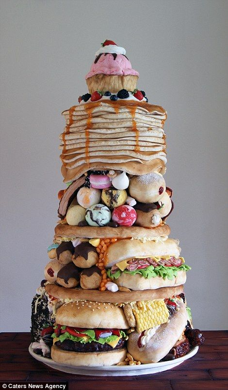 The foodie won gold in a 2014 competition with a food stack cake called 'The Big Eater' (right). It took her 150 hours just to make the tower, which included pancakes, a sub sandwich, doughnuts and more