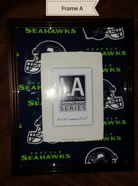 Check out this item in my Etsy shop https://www.etsy.com/listing/216985172/seattle-seahawks-picture-frame