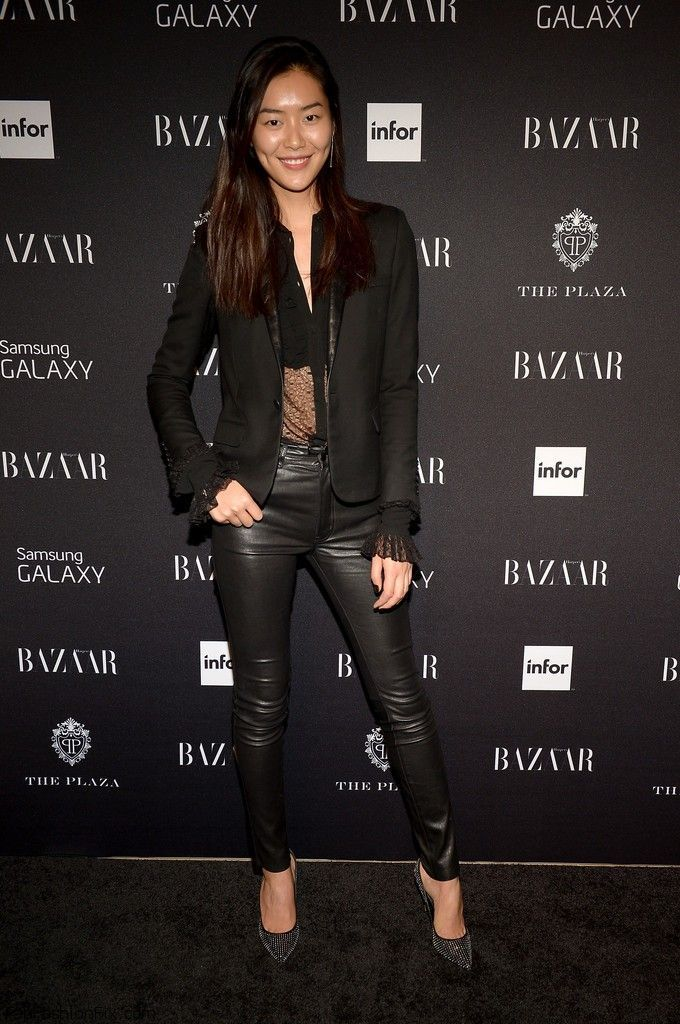 Chinese model Liu Wen was all smiles while attending the Samsung GALAXY At Harper's BAZAAR Celebrates Icons By Carine Roitfeld at The Plaza Hotel on September 5, 2014 in New York City. The 27-year-old Estée Lauder ambassador opted for edgy and sexy all black look by styling sheer blouse with skinny black leather pants and classic black blazer.