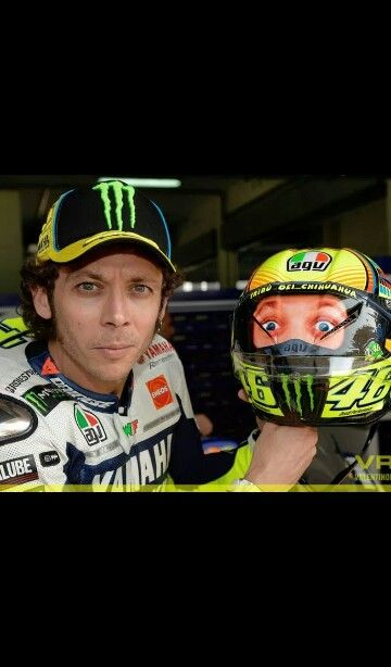 Valentino Rossi at sepang tests 2014 Love his helmet - the back has a sticker of the front on haha