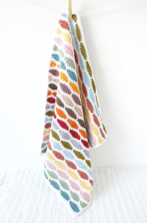 Crochet your own Bertie Baby Blanket! Easy to make with full instructions. Includes lots of photos to guide you through making this lovely bright