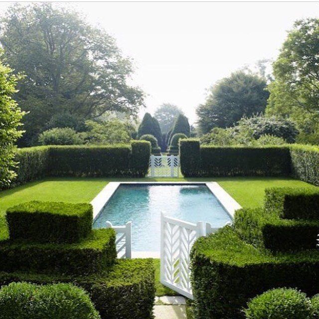 We love this downright dreamy pool in the South Hampton garden of Catie Marron designed by @miranda.brooks.gardens that's all hedges, lawn and symmetry. It's like a walled outdoor room of sculpted greenery really. With the addition of the prettiest gates we ever did see. It's a great lesson in texture and form being more important than colour and flowers. Thanks @horschinteriors for reminding us of the lovely oasis. Photo Christopher Baker @voguemagazine #pool #hedge #yew #lawn #grass #gate…