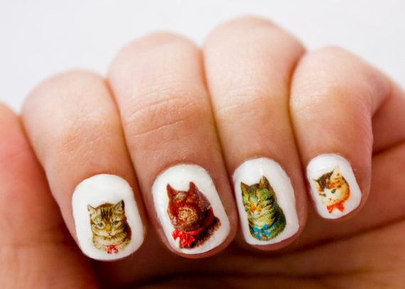 These little transfers are made from vintage illustrations of cats. There are 32 water transfers that blend in perfectly with clear or pale