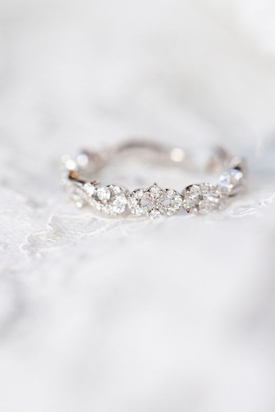 This beautiful @Kara Schneidawind wedding ring looks vintage inspired. It's dainty, feminine and timeless. We love how it still sparkles without taking away from your engagement ring.: