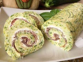 Il rotolo di zucchine è una frittata al forno con zucchine grattugiate, farcita con philadelphia e bresaola e infine arrotolata su se stessa.