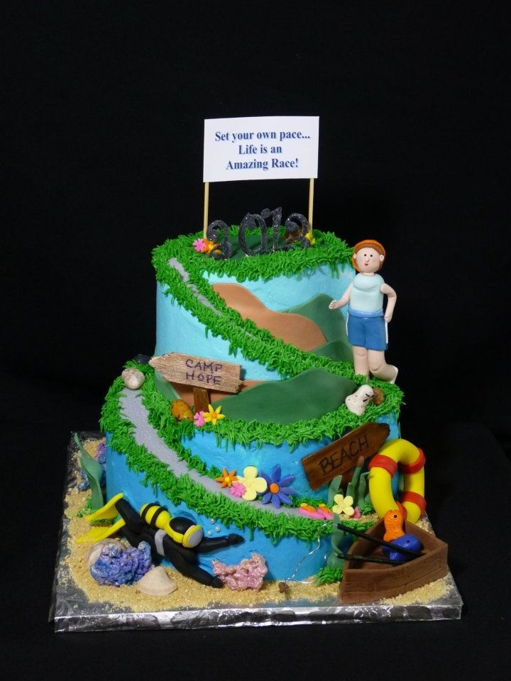 Life is an Amazing Race - Graduation theme: Set your own pace, life is an amazing race!  Graduation cake to represent the grads hobbies and interests.  Scuba diving, running, camp hope, fishing, boating, the beach.