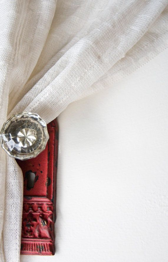 Vintage glass door knob used as a curtain tie back