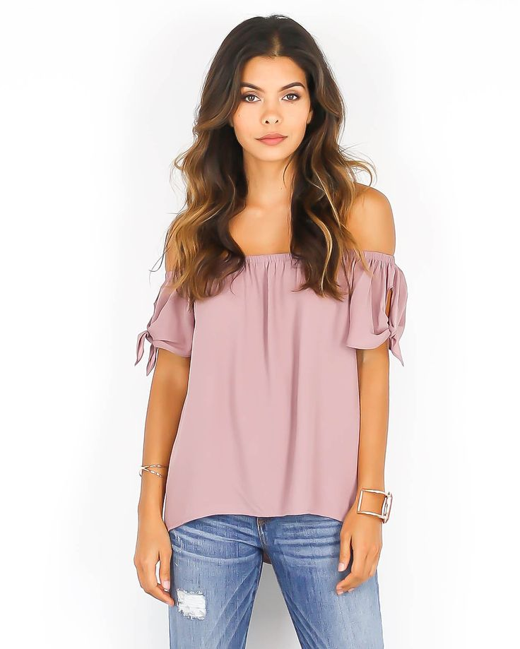 Well isn't this just the cutest top we've ever seen? A gorgeous and chic top that exudes the fashion forward off the shoulder trend. Side ties on the sleeves adds a sweet touch to this glamorous top.