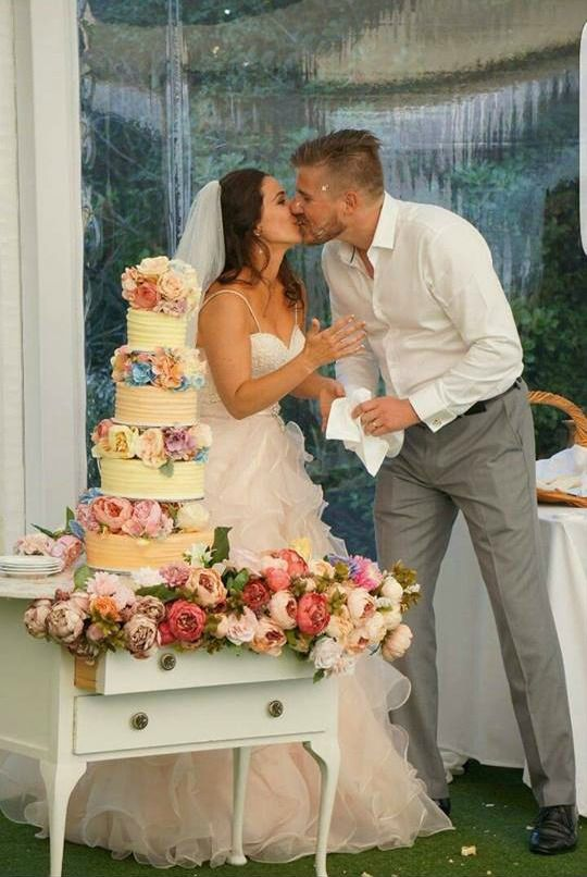 Kara and Steven on their Big Day so proud of that cake!
