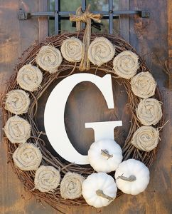 DIY Fall Wreath - Grapevine wreath with burlap flowers, painted pumpkins, and