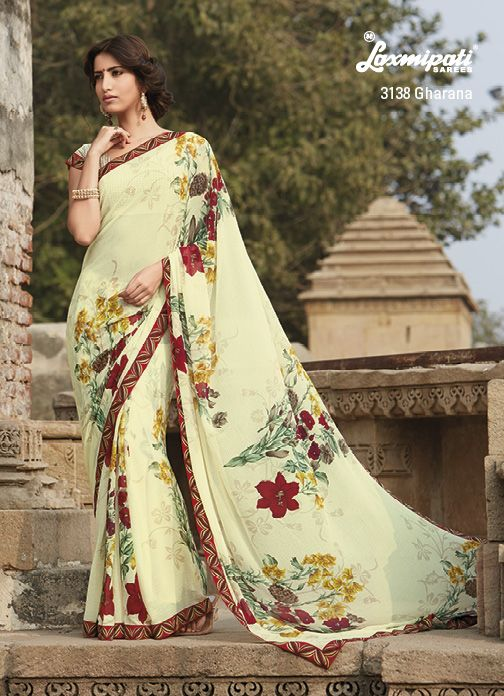 Time for some colourful splendour! Lemon yellow marvel chiffon saree is elegant looking with its floral prints & lace.
