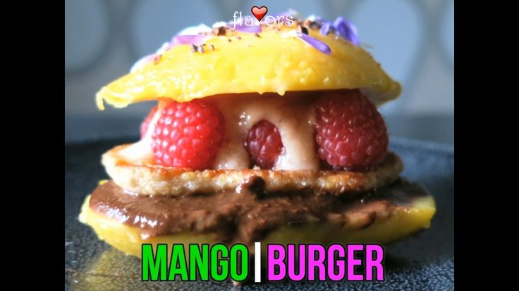 """❤ MANGO BURGER !! ❤ What are you having for breakfast ? How about this delicious Mango Burger !! It is so yummy especially with fresh Mangosteen purée... ❤❤❤❤❤ My mango burger recipe is unique and is constructed as follows; ▪️a sprinkle of cacao nibs on the top ▪️""""bachelor button"""" edible petals ▪️a fresh mango """"bun"""" ▪️mangosteen purée (OMG !  ) ▪️fresh raspberries ▪️macadamia, apple & oat pancake ▪️my homemade Natural Nutella ▪️all on a fresh mango base.... . ❤❤❤❤❤"""